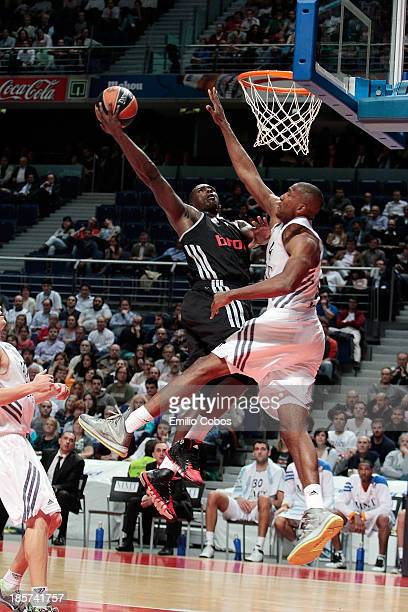 Sharrod Ford #15 of Brose Baskets Bamberg competes with Marcus Slaughter #44 of Real Madrid during the 20132014 Turkish Airlines Euroleague Regular...