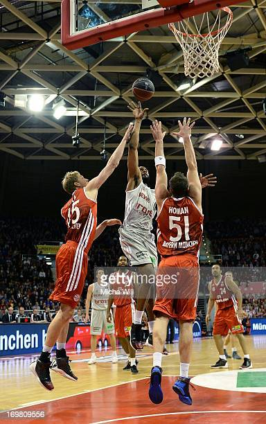 Sharrod Ford of Bamberg is challenged by Jan-Hendrik Jagla and Jared Homan of Muenchen during game 4 of the semi-finals of the Beko BBL playoffs...