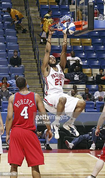 Sharrod Ford of the Fayetteville Patriots slams against the Arkansas RimRockers at the Crown Coliseum February 11, 2006 in Fayetteville, North...