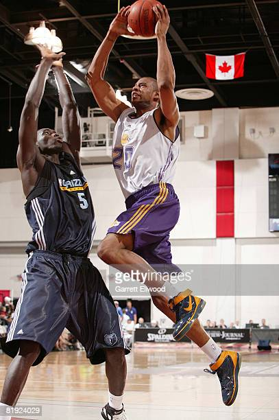 Sharrod Ford of the Los Angeles Lakers goes to the basket against Malick Badiane of the Memphis Grizzlies during NBA Summer League presented by EA...