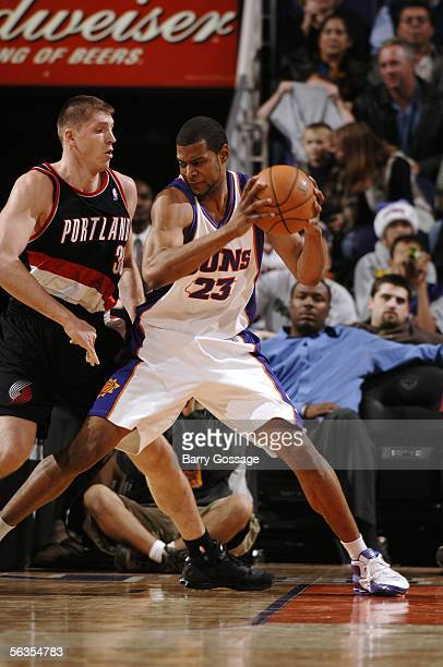 Sharrod Ford of the Phoenix Suns drives against Viktor Khryapa of the Portland Trail Blazers on December 6 2005 at America West Arena in Phoenix...