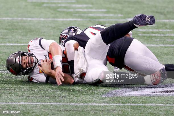 Sharrod Neasman of the Atlanta Falcons sacks Tom Brady of the Tampa Bay Buccaneers during the second quarter in the game at Mercedes-Benz Stadium on...