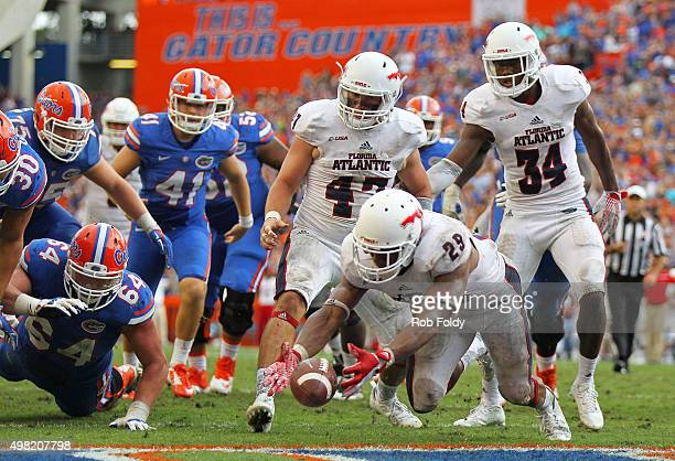 Sharrod Neasman of the Florida Atlantic Owls recovers the loose ball after the Owls blocked the extra point attempt following the Florida Gators...