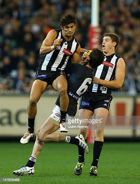 Sharrod Wellingham of the Magpies bumps Kade Simpson of the Blues during the round 15 AFL match between the Collingwood Magpies and the Carlton Blues...