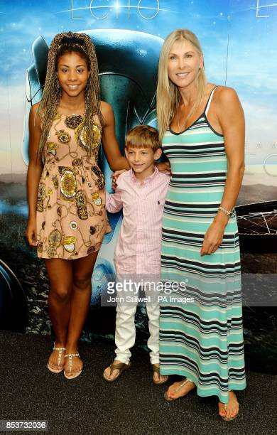 Sharron Davies with her children Grace and Fin arrive for a celebrity screening of the film Earth to Echo at the May Fair Hotel in central London
