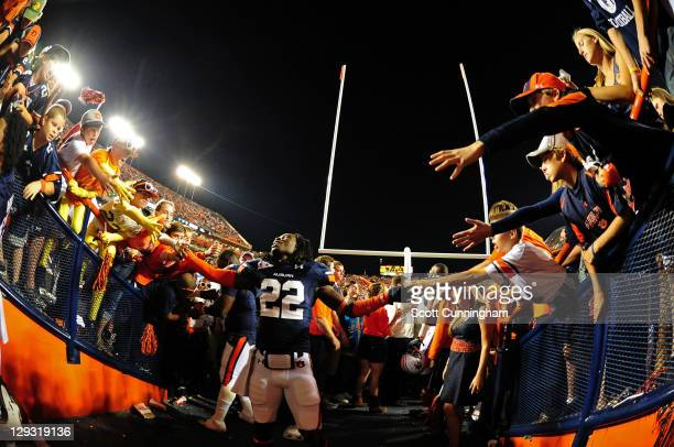Sharvan Bell of the Auburn Tigers celebrates with fans after the game against the Florida Gators at JordanHare Stadium on October 15 2011 in Auburn...