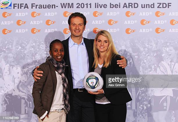 Shary Reeves, Claus Lufen and Nia Kuenzer pose during a photocall with the ARD and ZDF TV presenters for the FIFA Women World Cup 2011 at the...