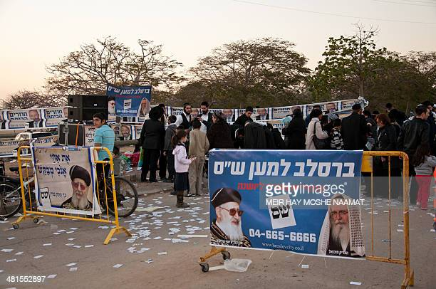 Shas Party members gathering signatures from passersby to vote for Shas. Taken in the market outside of Baba Sali tomb, Netivot, Israel.