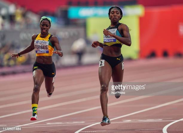 Shashalee Forbes of Jamaica and Anthonique Strachan of Bahamas competing in the 200 meter for women during the 17th IAAF World Athletics...