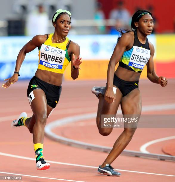 Shashalee Forbes of Jamaica and Anthonique Strachan of the Bahamas compete in the Women's 200 metres heats during day four of 17th IAAF World...