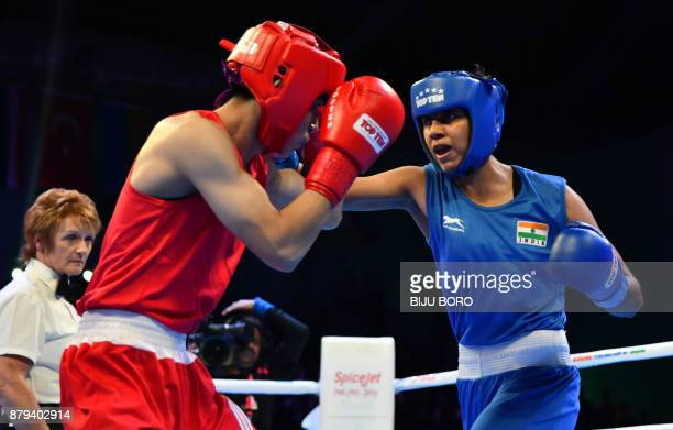 Shashi Chopra of India and Ngoc Hong Do of Vietnam take part in the final bout of the Women's Featherweight category at the AIBA Youth Women's World...