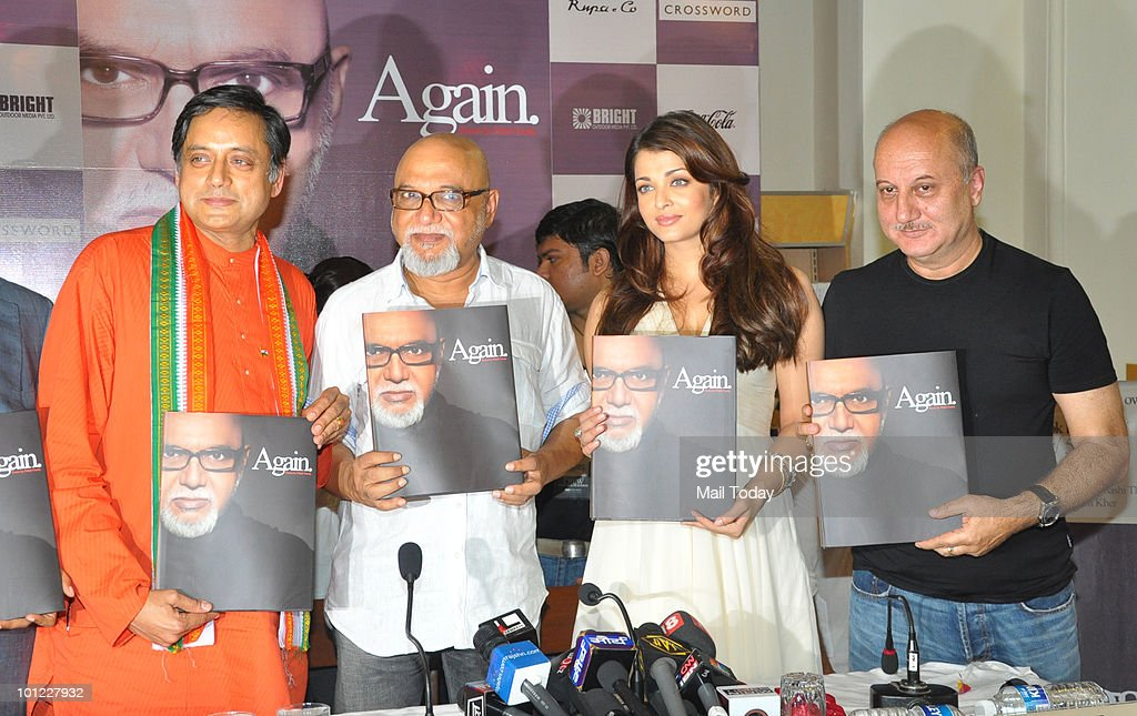 Shashi Tharoor poet Pritish Nandy and Bollywood actors Aishwarya Rai Bachchan and Anupam Kher unveil Nandy�s book of poems `Again` in Mumbai on May...