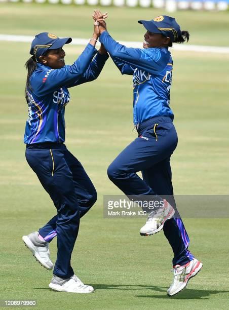 Shashikala Siriwardena of Sri Lanka and Nilakshi de Silva of Sri Lanka celebrate Chamari Attapaththu captain of Sri Lanka catching the wicket of Amy...