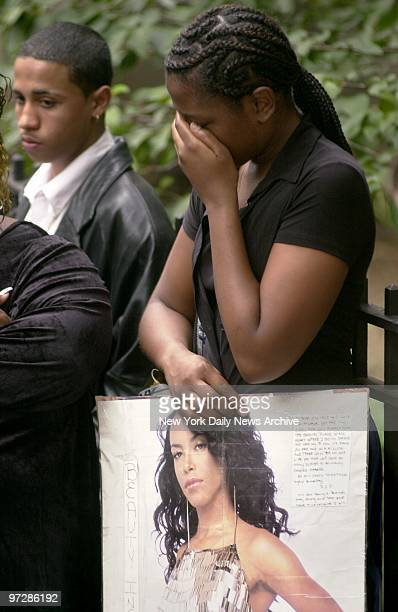 Shatika Wallace of Longbranch NJ holds a handlettered tribute to RB star Aaliyah as she weeps outside the Frank E Campbell Funeral Chapel on 81st St...