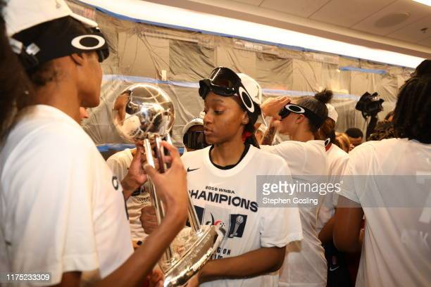 Shatori WalkerKimbrough of Washington Mystics holds the trophy in the locker room after winning the 2019 WNBA Finals during Game Five of the 2019...