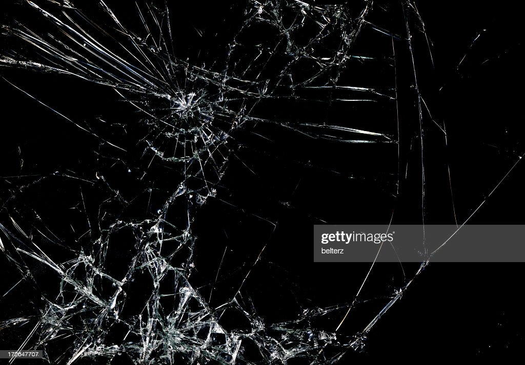 Shattered glass in dark background : Stock Photo