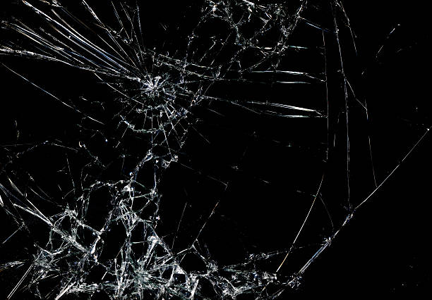 Free broken glass images pictures and royalty free stock photos shattered glass in dark background voltagebd Gallery