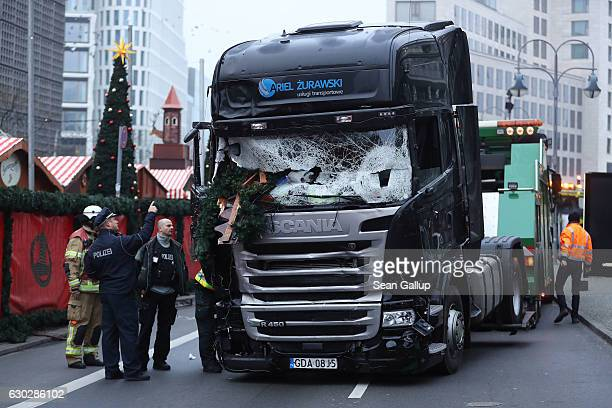 shattered glass is seen on the windshield of a truck the morning after it ploughed through a Christmas market on December 20 2016 in Berlin Germany...