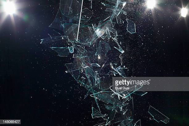 shattered glass mid-air - shattered glass stock pictures, royalty-free photos & images