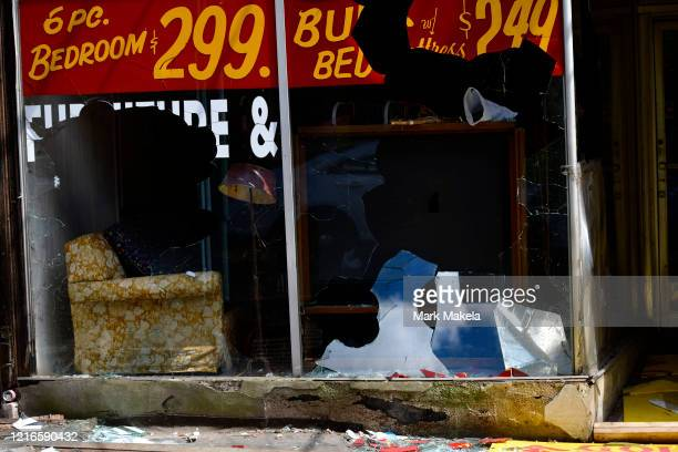 Shattered glass shimmers at a looted furniture store on May 31 2020 during a protest of the death of George Floyd on May 31 2020 in Philadelphia...