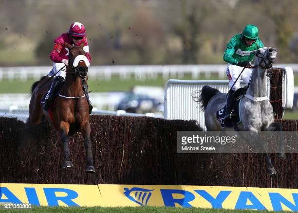 Shattered Love ridden by Jack Kennedy jumps the last in front of Terefort ridden by Daryl Jacob on their way to victory in the JLT NoviicesÕ Chase at...