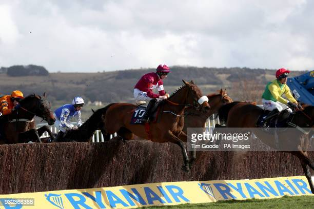 Shattered Love ridden by jockey Jack Kennedy during the first lap of the JLT Novices' Chase during St Patrick's Thursday of the 2018 Cheltenham...
