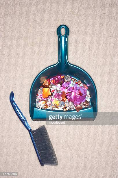 shattered ornament in a dustpan - dustpan and brush stock pictures, royalty-free photos & images