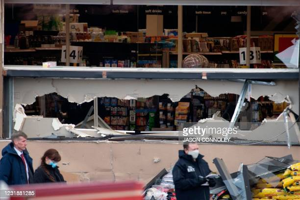 Shattered windows and the damaged facade of the King Soopers grocery store in Boulder, Colorado where a mass shooting took place on March 22, 2021. -...