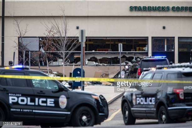 Shattered windows are shown at a King Soopers grocery store after a shooting on March 22, 2021 in Boulder, Colorado. Dozens of police responded to...