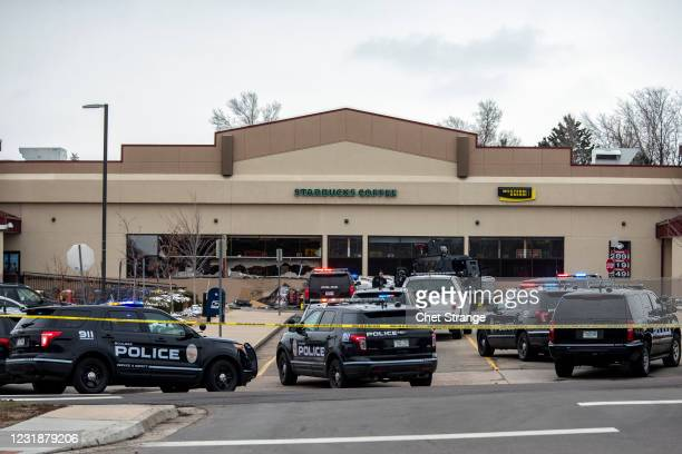 Shattered windows are shown in front of a King Soopers grocery store where a gunman opened fire on March 22, 2021 in Boulder, Colorado. Dozens of...