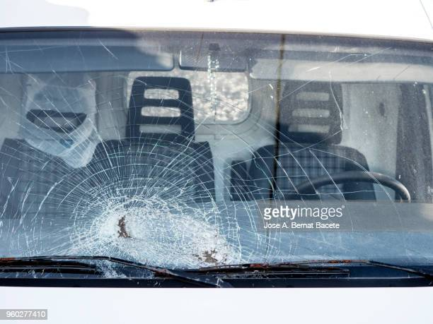 shattered windshield after car crash. vehicle accident. broken glass. - exploding glass stock photos and pictures