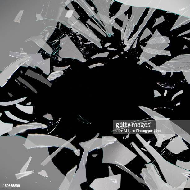 shattering glass - shattered glass stock pictures, royalty-free photos & images