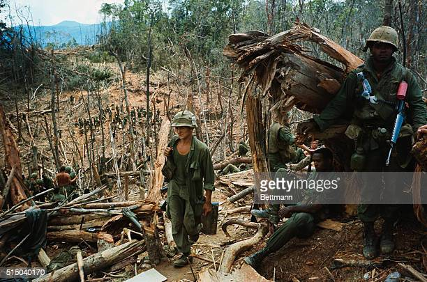 A Shau Valley South Vietnam Smoke flare marks landing spot for evacuation helicopter coming in to take out US 1st Cavalrymen wounded in the battle...