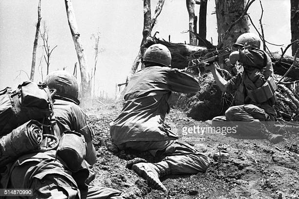 3/20/1969A Shau Valley South Vietnam Two members of the 101st Airborne Division fire into a North Vietnamese bunker near the top of 'Hamburger Hill'...