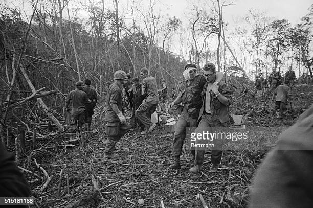 4/30/1968A Shau Valley South Vietnam Wounded American soldiers are assisted by buddies during Operation Delaware in this valley in South Vietnam's...