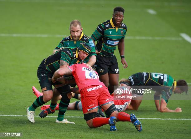 Shaun Adendorff of Northampton Saints is tackled by Jono Ross during the Gallagher Premiership Rugby match between Northampton Saints and Sale Sharks...