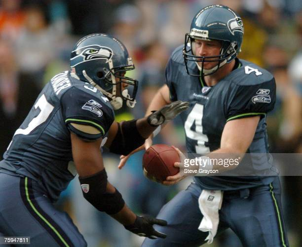 Shaun Alexander and Trent Dilfer of the Seattle Seahawks in action during their contest against the Miami Dolphins at Qwest Field Novmeber 21 2004