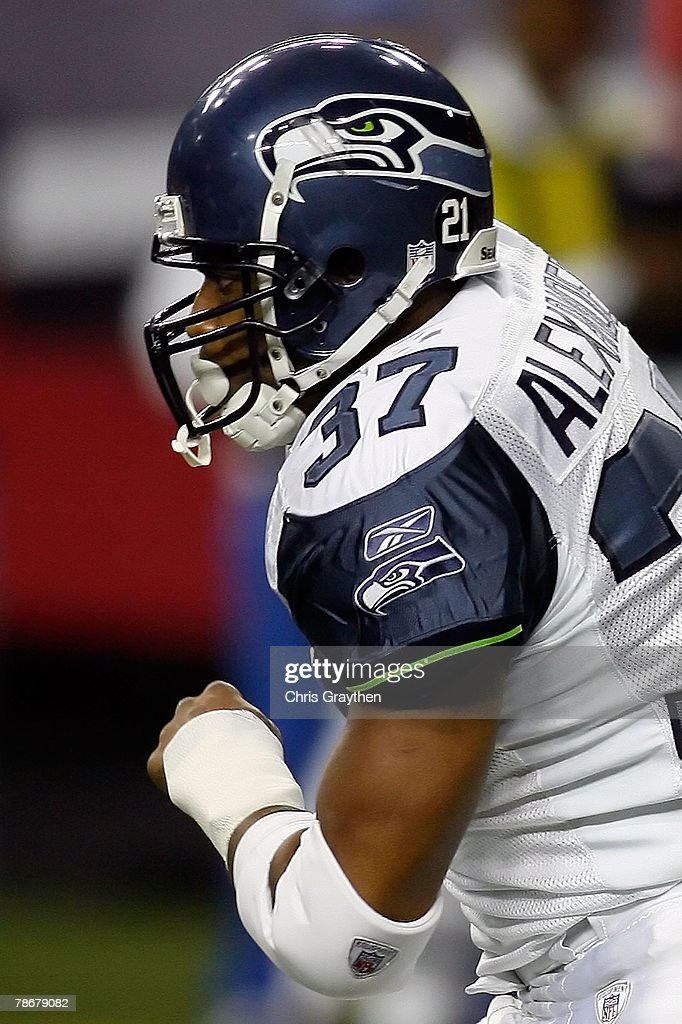 Shaun Alexander #37 of the Seattle Seahawks runs against the Atlanta Falcons at the Georgia Dome December 30, 2007 in Atlanta, Georgia. The Falcons defeated the Seahawks 44-41.