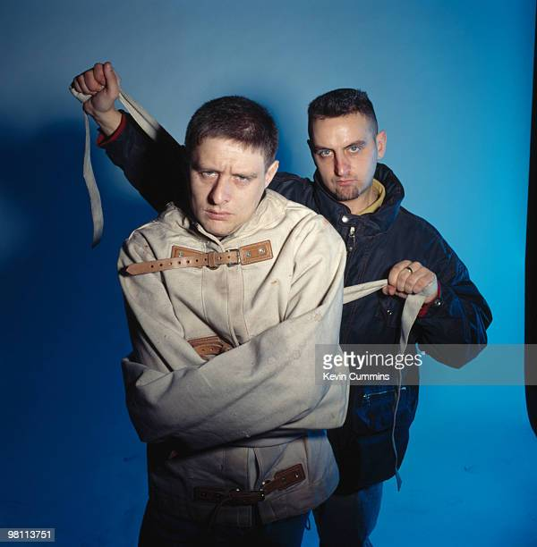 Shaun and Paul Ryder of pop group Happy Mondays 1992 Bassist Paul is holding the straps to his brother's strait jacket