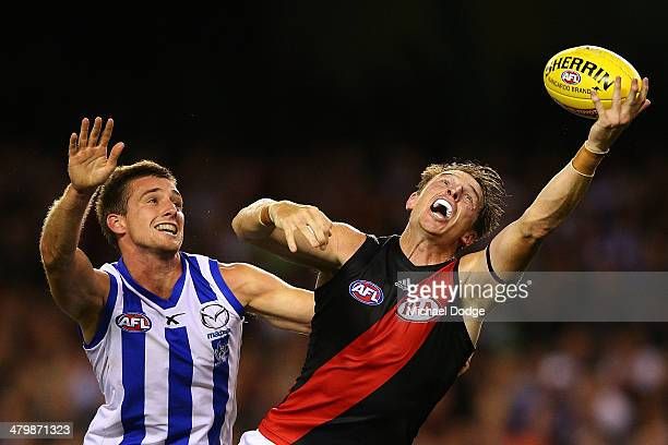 Shaun Atley of the Kangaroos and Brendon Goddard of the Bombers contest for the ball during the round one AFL match between the North Melbourne...