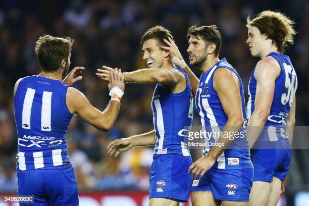 Shaun Atley of the Kangaroos celebrates a goal during the round five AFL match between the North Melbourne Kangaroos and the Hawthorn Hawks at Etihad...