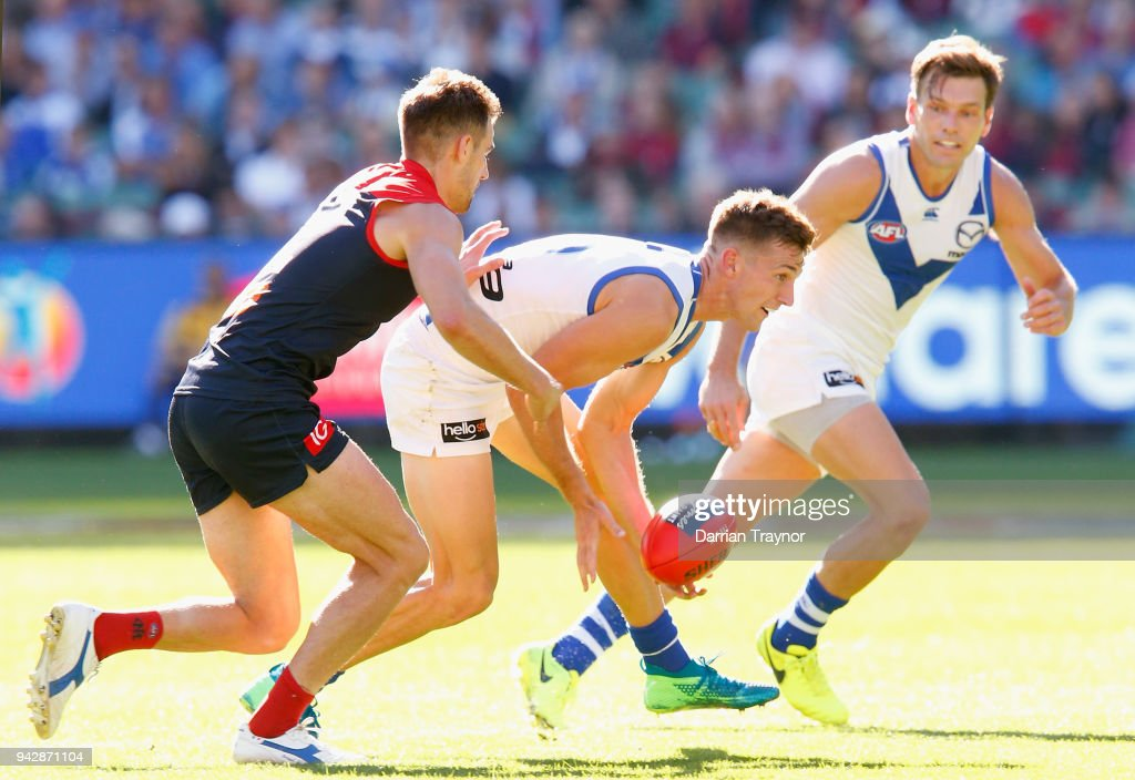 Shaun Atley of the Kangaroos handballs during the round three AFL match between the Melbourne Demons and the North Melbourne Kangaroos at Melbourne Cricket Ground on April 7, 2018 in Melbourne, Australia.