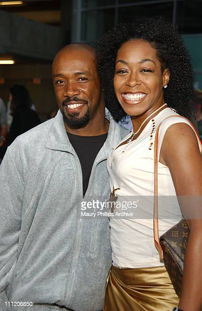 Shaun Baker and Tichina Arnold during Martin Lawrence Live Runteldat World Premiere at ArcLight Cinemas in Hollywood California United States