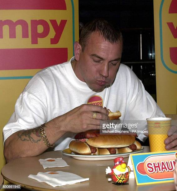 Shaun Barry from Birmingham tucks into a plate of hot dogs during an eating contest at the Trocadero Centre in London's West End Mr Barry already...
