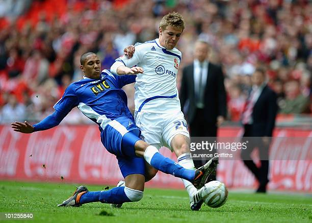 Shaun Batt of Millwall battles with Danny Ward of Swindon during the CocaCola League One Playoff Final between Millwall and Swindon Town at Wembley...