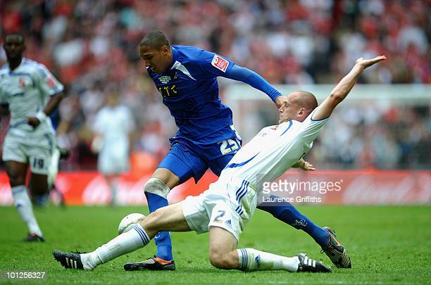 Shaun Batt of Millwall battles with Scott Cuthbert of Swindon during the CocaCola League One Playoff Final between Millwall and Swindon Town at...