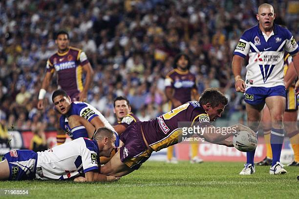 Shaun Berrigan of the Broncos dives over the line to score the first Broncos try during the NRL First Preliminary Final match between the Bulldogs...