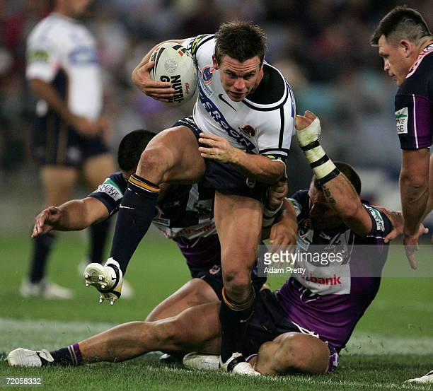 Shaun Berrigan of the Broncos is tackled during the NRL Grand Final match between the Brisbane Broncos and the Melbourne Storm at Telstra Stadium on...