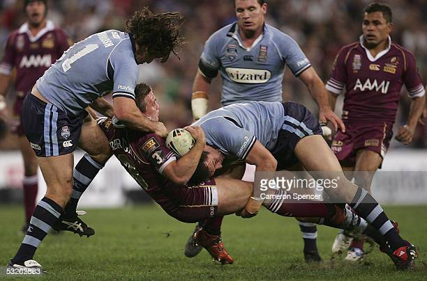 Shaun Berrigan of the Maroons is tackled during game three of the ARL State of Origin series between the Queensland Maroons and the New South Wales...