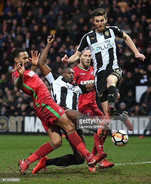 Shaun Brisley and Foluwashola Ameobi of Notts County get past the Swansea City defance during The Emirates FA Cup Fourth Round match between Notts...